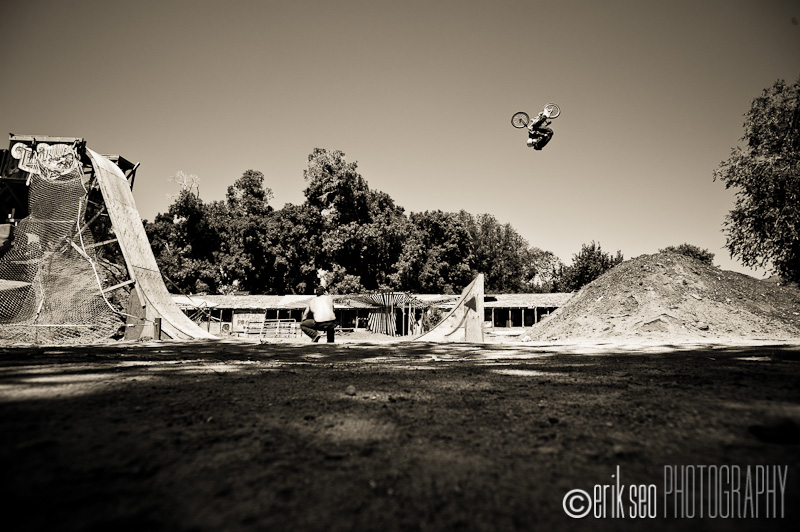 Pat Laughlin front flipping the redneck mini-mega ramp on his BMX bike at the Thrillbillies Compound.