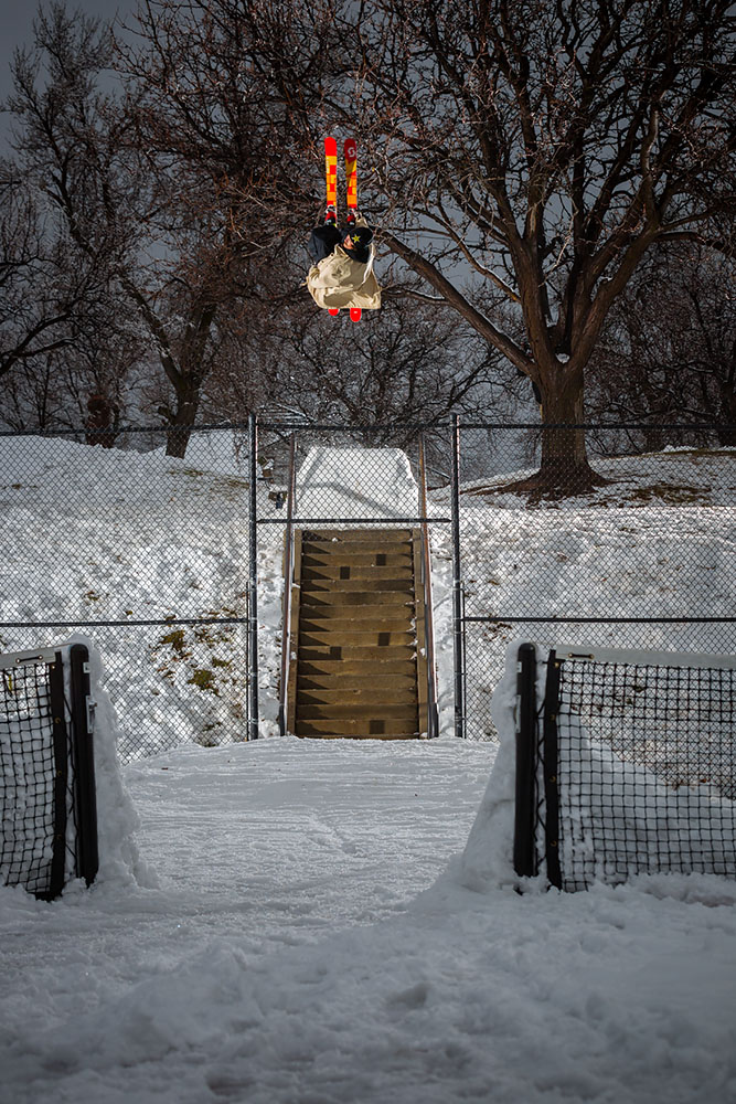 "Ski photography of X-Games freeskiing silver medalist McRae Williams jumping over a fence in Salt Lake City, Utah while filming urban street skiing for his video part in the Level 1 Productions ski movie ""Pleasure"""